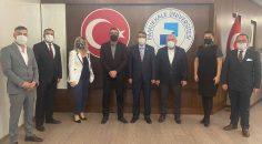 MHP'DEN REKTÖR KUTLUHAN'A NEZAKET ZİYARETİ